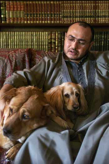 Dr. Khaled Abou El Fadl with his rescued dogs.